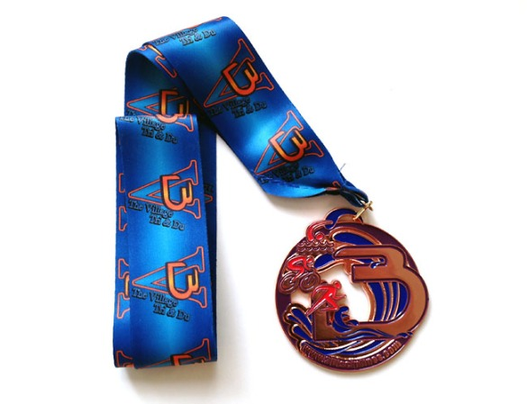 Very cool medal from The Village Triathlon!