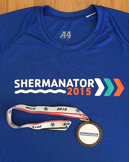 My age group medal along with the great race shirt. Sure to be a new favorite of mine.