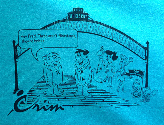 A cute Flintstones shirt that refers to the bricks at the start and finish of the race.
