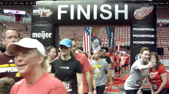 There I am in the blue hat after I FINALLY got to cross the finish line
