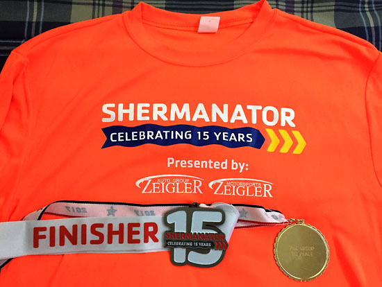 A long sleeve race shirt along with the official medal and the back of my age group medal