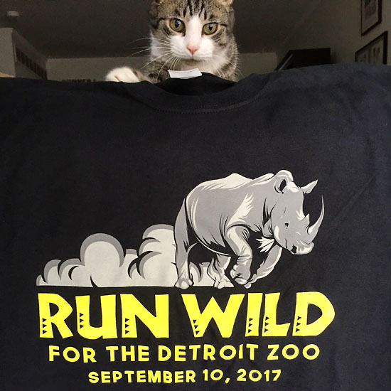 Romeo always wants to be a part of the action, so of course he was there to photo bomb my picture of the race shirt